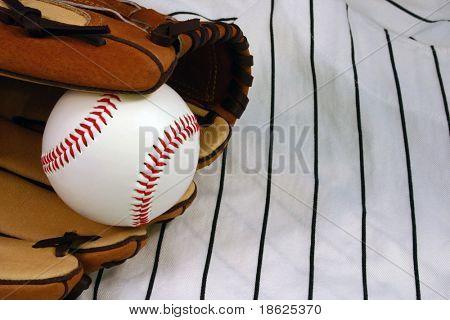 Baseball in a glove on a uniform.