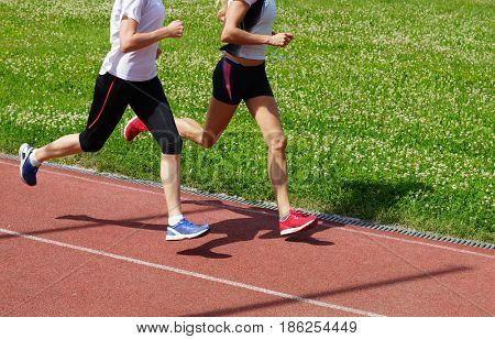 Women athletes running on the treadmill, morning exercises.