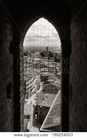 Windown view from City Hall Bell Tower in old medieval town Siena in Italy