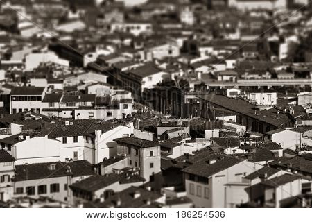 Roofs of old buildings in Florence in Italy tilt-shift effect black white