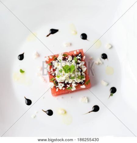 Watermelon feta top view. This watermelon cubes salad is made with greek feta cheese crumbs olive slices mint olive oil and balsamic vinegar. So refreshing the perfect food for the summer!