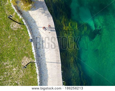 Aerial view of  man and woman on walking path by Una river, Bosnia and Herzegovina.