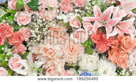Flowers and love concept - Beautiful pink tone color effect of many flowers on flowers wall in love event. Use for flowers and love artwork concept