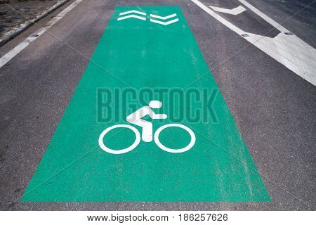 Bike lane sign with arrow pavement marking on asphalt road for exercise