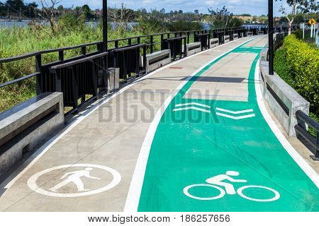 Walk and bike lane. Signs for bicycle and walking painted on the concrete lane for exercise