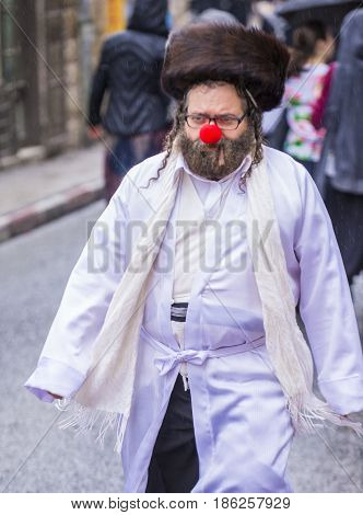 JERUSALEM - MARCH 13 : Ultra Orthodox man during Purim in Mea Shearim Jerusalem on March 13 2017 Purim is a Jewish holiday celebrates the salvation of the jews from genocide in ancient Persia