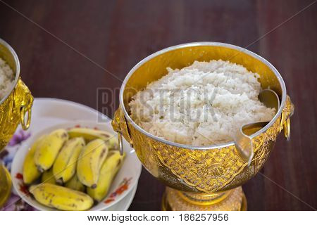 Rice in ancient bowl for offering alms to the monks