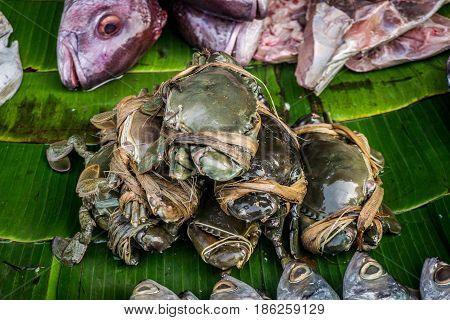 crab on banana leaf on traditional market in bogor indonesia java
