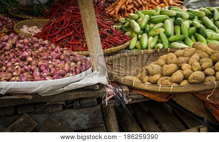 red onion potato cucumber and red chilli with bamboo wooden basket on traditional market in bogor indonesia java