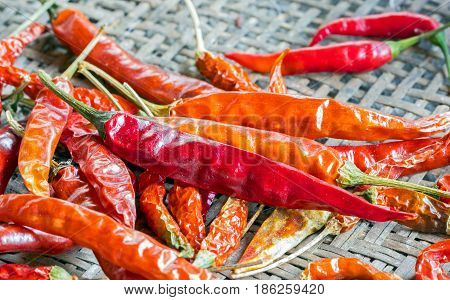red Sun-dried chilli on brown bamboo plate