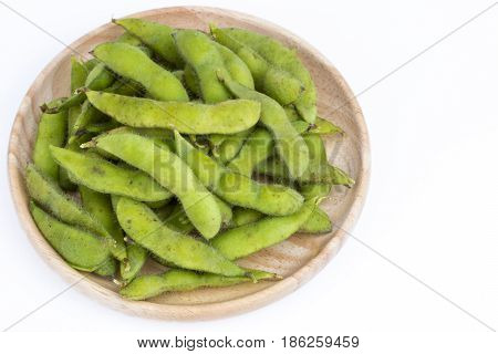 Green Soybean (vegetable Soybean) Boiled In Wooden Plate On White