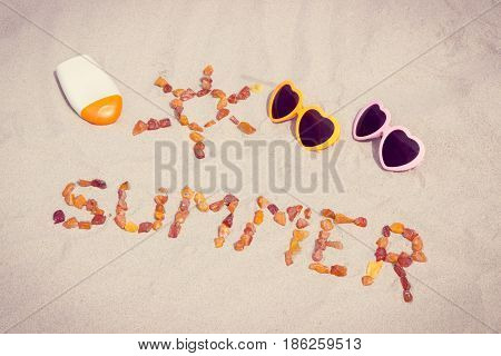 Shape Of Sun And Word Summer, Sunglasses And Sun Lotion On Sand At Beach