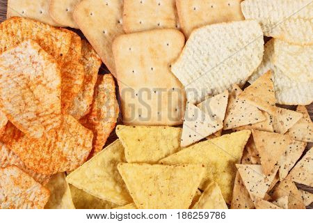 Heap Of Crunchy Cookies And Salted Potato Crisps, Concept Of Unhealthy Food