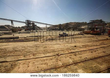 A construction site with a lot of dirt and travelators