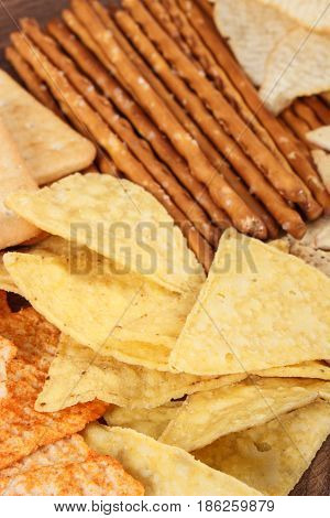 Heap Of Salted Potato Crisps, Breadsticks And Cookies, Concept Of Unhealthy Food