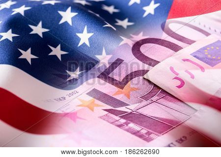 American flag and euro banknotes. Usa flag and euro money.