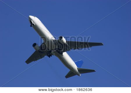 White Airplane On Blue Background