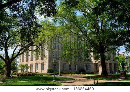 North Carolina State Capitol Building with Green Trees on a Sunny Day