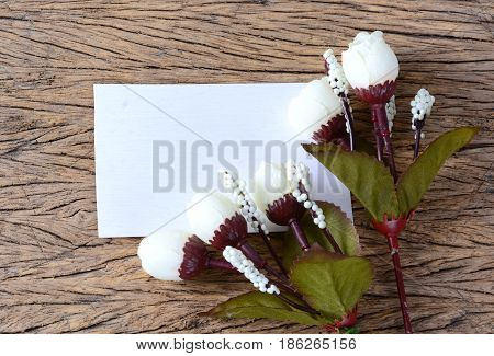 Cloe up of empty paper card with spring flowers