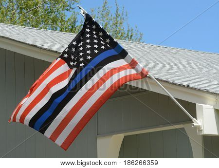 United States flag with blue line to honor police and law enforcement officers