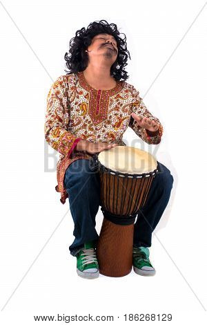 Portrait of musician man playing the djembe