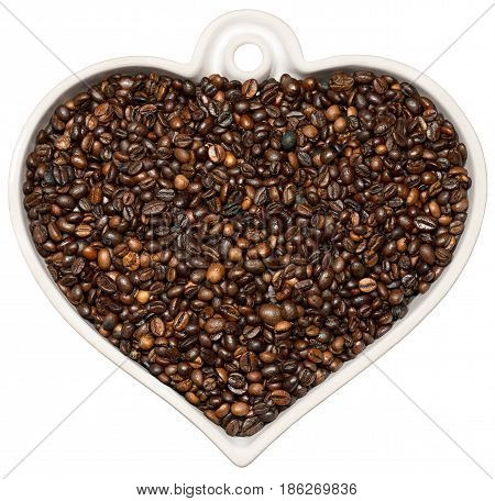 Roasted coffee beans in a heart shaped bowl isolated on a white background. Love Coffee concept