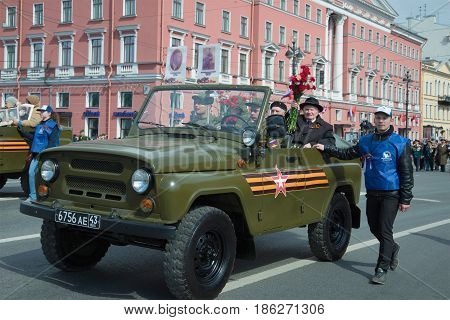 ST PETERSBURG, RUSSIA - MAY 09, 2017: Veterans of the Great Patriotic War in a UAZ car. Festive procession along Nevsky Prospekt on Victory Day