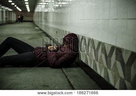 Homeless Woman Sleeping on The Floor
