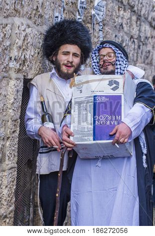 JERUSALEM - MARCH 13 : Ultra Orthodox men holding Mishloach Manot during Purim in Mea Shearim Jerusalem on March 13 2017 Mishloach Manot is traditional food gifts given during Purim