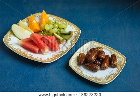 Sweet dates, fresh and healthy fruits are consumed before breaking fast during holy month of Ramadan. An Iftar meal ritual of muslims around the world.