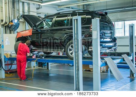 Huge garage for car repair with the necessary equipment