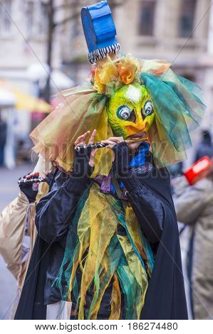 BASEL SWITZERLAND - MARCH 08 : Participant in the Basel Carnival in Basel Switzerland on March 08 2017. The Basel carnival has been listed as one of the top local festivities in Europe