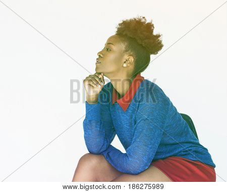 African woman sitting on the table and white background