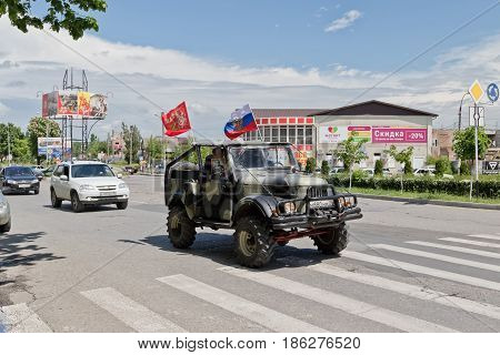 Cars Decorated With Flags Driving Around City Streets In Celebration Of The Victory Day