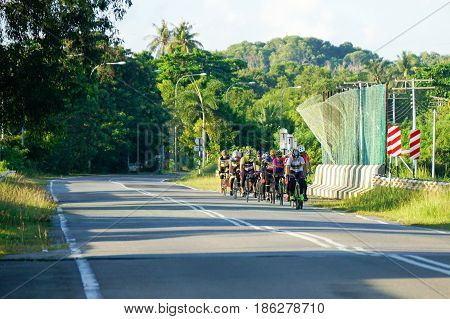 Labuan,Malaysia-May 10,2017:Group of cyclists enjoying cycling on a sunny day in Labuan island,Malaysia.Malaysia is encouraging people to cycle not just for recreation but to commute to work.