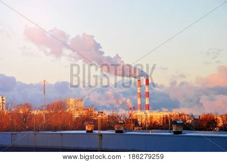 Early Morning With Down Sun Light, A View To The Industrial Landscape Of The City With Smoke Emissio