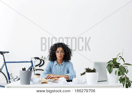 Serious Mixed Race Columnist With Afro Haircut Suffering From Writer's Block, Sitting In Office With