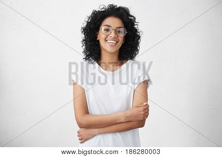 Youth And Carefree Lifestyle Concept. Happy Young Woman Freelancer With Black Curly Hair Relaxing At