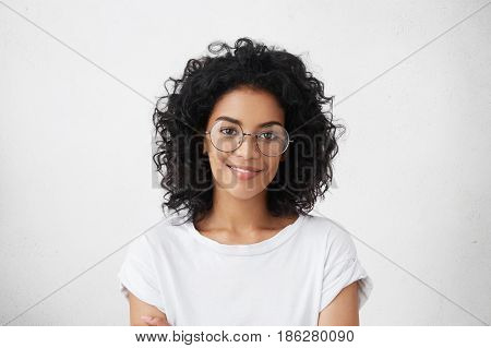 Close Up Studio Shot Of Beautiful Young Mixed Race Woman Model With Curly Dark Hair Looking At Camer