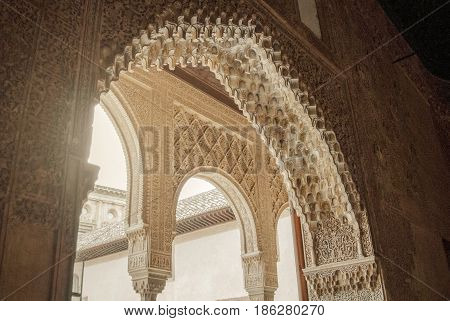 Granada, Spain - February 10, 2015: A Close-up View To Calligraphy Decorated Details Of An Archway A
