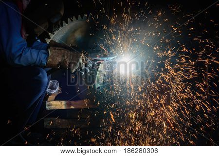 Gouging welding steel structure and bright sparks in steel construction industry.