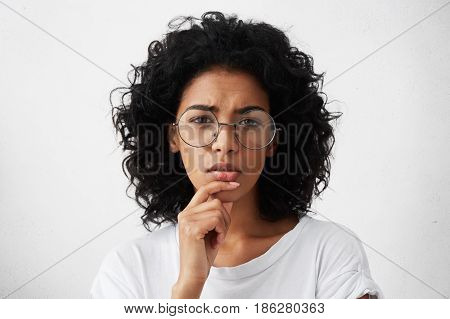 Let Me See. Beautiful Young Woman In White T-shirt And Big Round Spectacles Squeezing Her Eyes In Pe