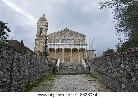 MONTALCINO,ITALY-APRIL 24,2016:Church of the Holy Savior in Montalcino during a cloudy day.