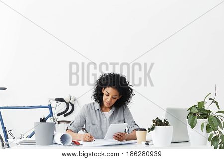 Successful Skilled Professional Afro American Woman Engineer Working On Construction Project At Her