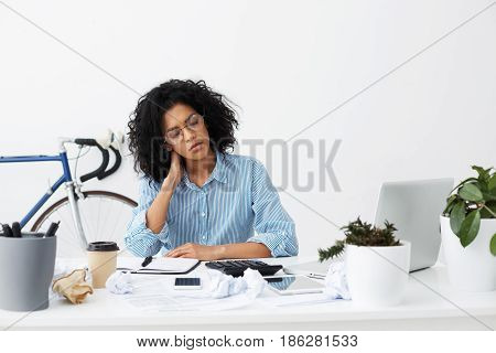 Young Dark-skinned Freelancer Accountant Almost Sleeping After Managing Annual Financial And Tax Rep