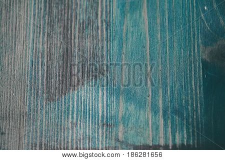 Navy blue wood texture. Turquoise wood background. Closeup view of blue wood texture and background. Abstract background and texture for designers. Texture of vintage handmade table. Rustic table.