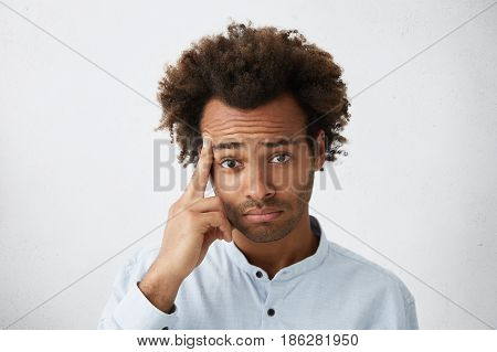 Human Emotions, Feelings, Reaction And Attitude. Headshot Of African American Male Holding Middle Fi