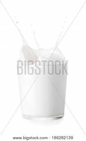 splashes of milk from the glass isolated on white background. Glass of milk. Pouring milk