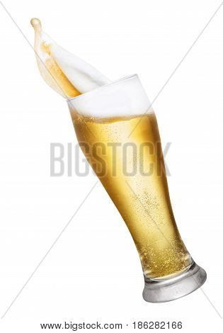 glass of splashing beer isolated on white background. Glass with beer up. Golden beer splash. Falling glass of beer