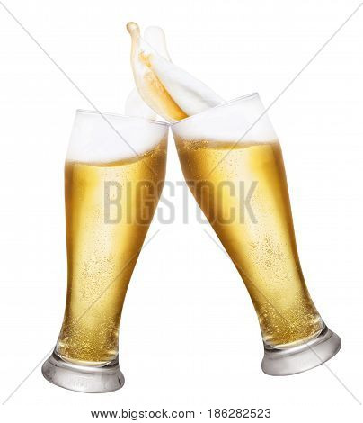 two glasses of beer toasting creating splashes isolated on white background. Pair of beer glasses making toast. Glasses with beer up. Golden beer splash